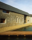 Renovated farmhouse with stone facade and water-filled pool