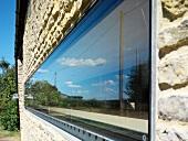 Horizontal, narrow window in stone facade