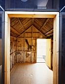 View through doorway into old, empty barn