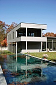 Modern villa with swimming pool in garden