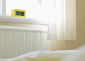 Digital clock on bedroom windowsill