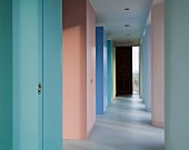 Rainbow of pastel shades on wall elements in modern hallway