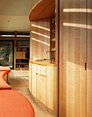 Modern room with bar in wooden niche