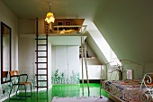 Child's bedroom with nostalgic metal frame and ladder leading to gallery