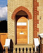 House entrance with arched door
