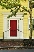 Yellow house with red front door