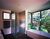 Bathroom with large windows to garden