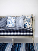 Rococo-style bench and cushions with rustic motifs