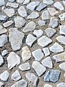 Pebbles pressed into sand