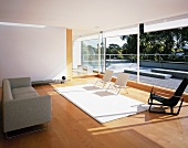 Large living room with seating and sliding glass doors leading to roof terrace