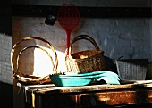 Baskets on wooden table in shed