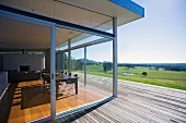House with glass wall leading to terrace