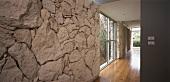 View past limestone wall into hallway