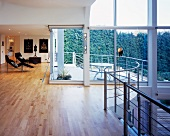 Large living room with glass wall and balcony