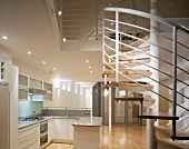 Open-plan kitchen with spiral staircase