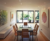 Dining room with glass table and wicker chairs
