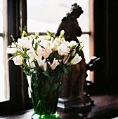 Lisianthus in green glass vase