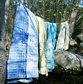 Bedspreads hanging on a washing line
