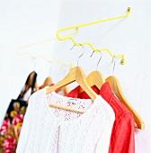 Woman's clothing on coathangers