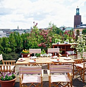 Set table on roof terrace with view across Stockholm