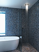 Shower area and bathtub in bathroom with mosaic tiles