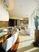 Penthouse apartment with tasteful modern living-dining room furnishings