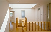 Landing with large skylight in roof and openings to lower storey with traditional wooden balustrades