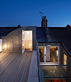 Evening sky above modern extension to apartment with roof terrace in old London building