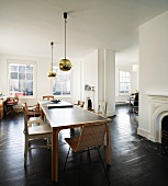 Mix of furnishing styles in living-dining room of spacious London apartment in old building