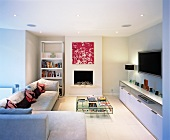 Contemporary fireplace with sofas and elegant sideboard