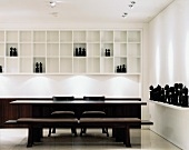 Elegant, designer dining area with collection of black, African figures