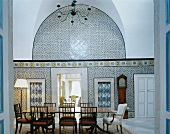 Traditional, North African wall tiles in dining room with antique European furniture
