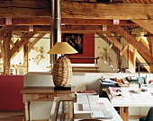 Wicker lamp with lampshade - home office on gallery in old, converted barn