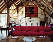 Mix of styles in spacious converted barn - living area with pink sofa