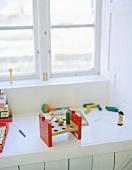 Child's toys on white windowsill
