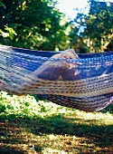 Toddler and mother in hammock
