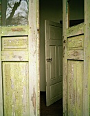 Weathered exterior door with missing pane of glass