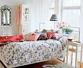 Inviting bedroom with patterned bed linen and scatter cushions