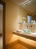 Modern bathroom with large mirror and glass sink