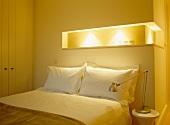 Modern bedroom with double bed and indirect lighting