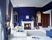Modern living room furnishings and blue-painted walls in traditional setting