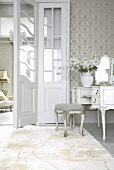Rococo dressing table and upholstered stool next to open double doors