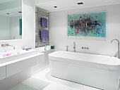 White designer bathroom with modern picture on wall