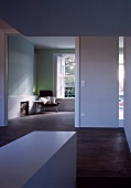 Anteroom with wide doorway and view into minimalist living space