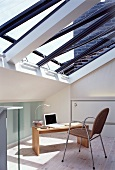 Modern home office below slanting glass roof