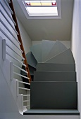 Bottom view of a modern spiral staircase in stairwell