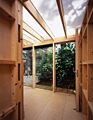 View into wooden extension with open garden door
