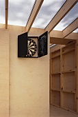 Dartboard on wooden wall of extension