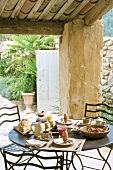 Breakfast table on roofed terrace