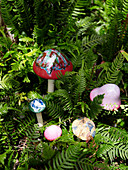 Decorative mushrooms amongst ferns